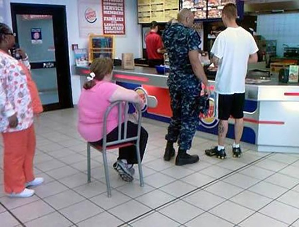 sitting on chair in line at burger king