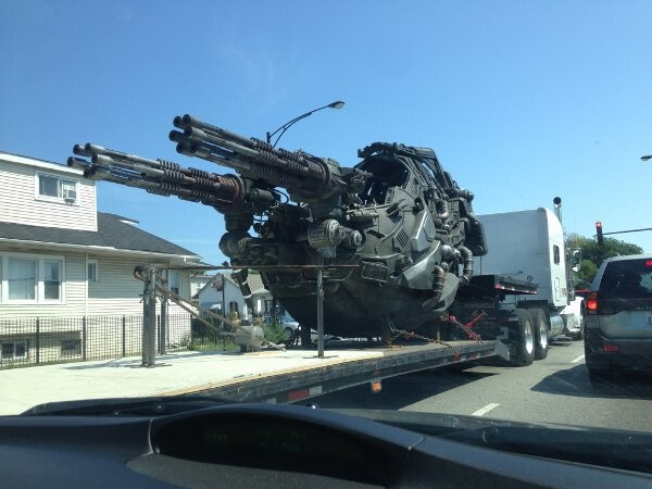 machine gun movie prop being delivered