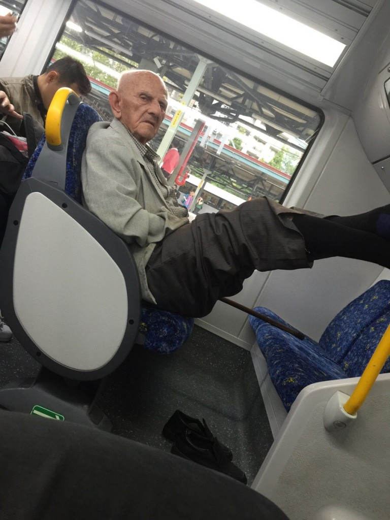 grumpy old man with his feet up
