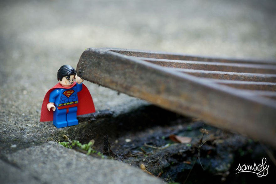 lego superman lifting a grate