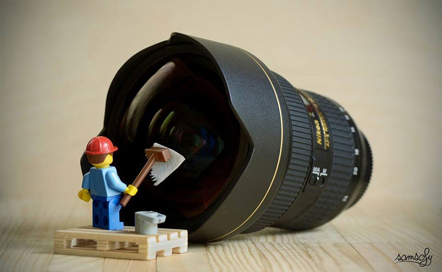 lego figure cleaning a camera lens