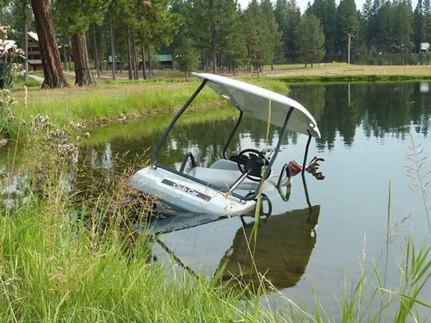 golf cart in pond