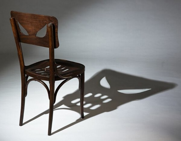 chair with angry face shadow