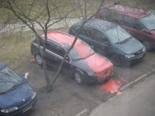 red paint spilled on car