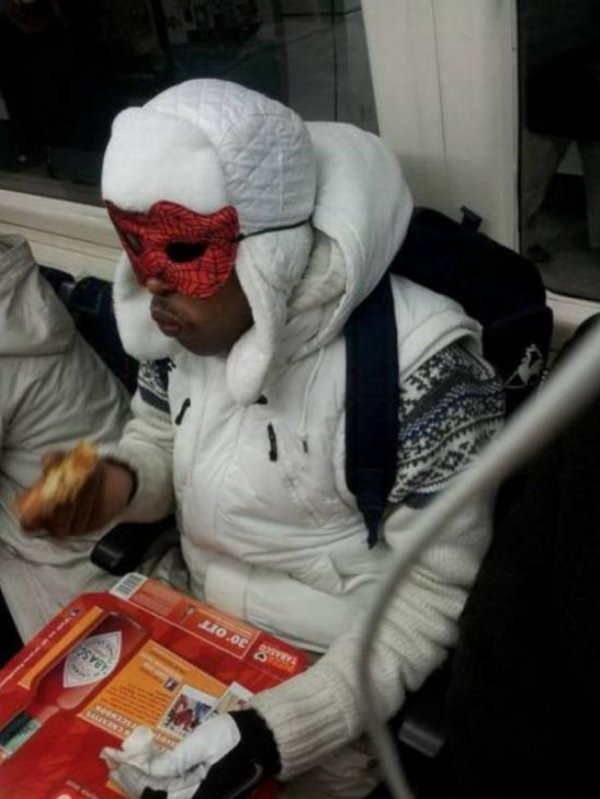 guy with a spider man mask eating