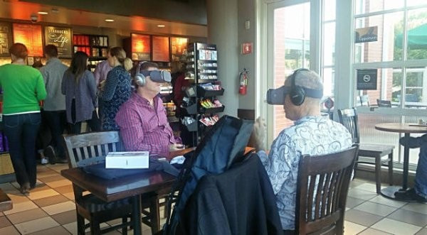 two men in cafe with virtual reality on